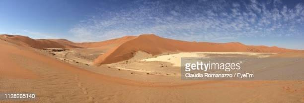 panoramic view of desert against sky - claudia romanazzo foto e immagini stock