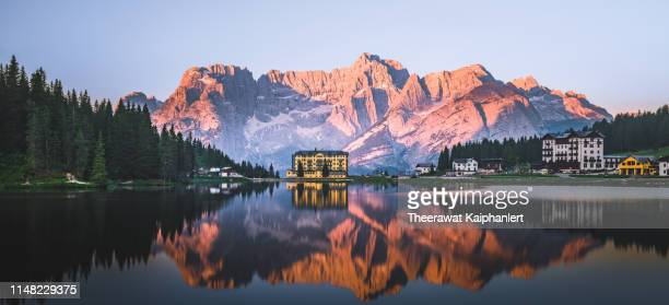 panoramic view of dolomites mountain range in summer, italy - belluno stock pictures, royalty-free photos & images