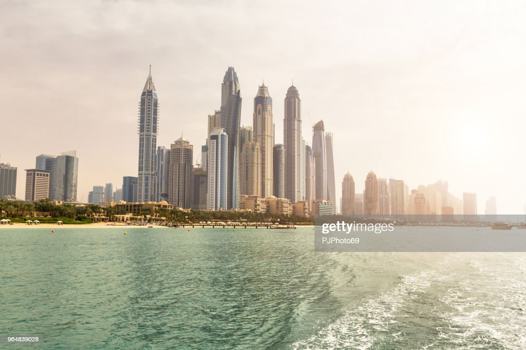 Panoramic view of Dubai from sea at sunset during a cruise : Foto stock