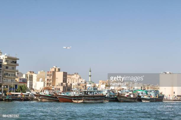panoramic view of dubai from the creek river - pjphoto69 stock pictures, royalty-free photos & images