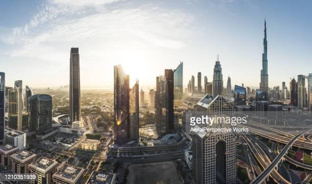 panoramic view of dubai skyline - dubai stock pictures, royalty-free photos & images