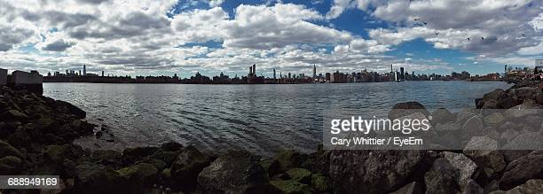 Panoramic View Of East River Against Cloudy Sky