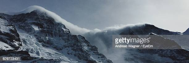 Panoramic View Of Eiger Against Sky During Foggy Weather