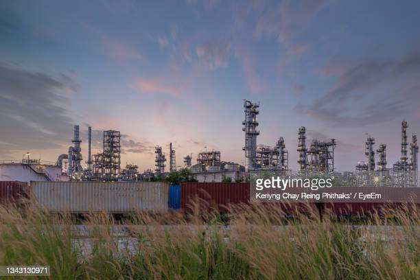 panoramic view of factory against sky during sunset - greenpeace stock pictures, royalty-free photos & images