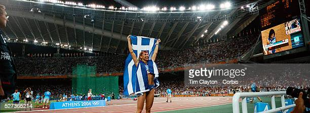 A panoramic view of Fani Halkia of Greece as she celebrates winning gold in the women's 400 meter hurdle final during the Athens 2004 Summer Olympic...