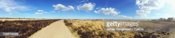 panoramic view of field against cloudy sky - hoogeveen stock pictures, royalty-free photos & images
