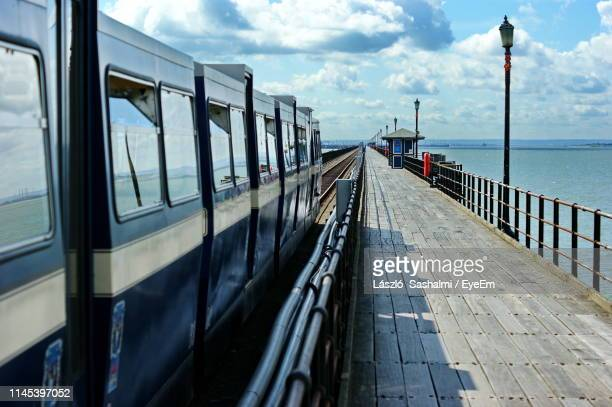 panoramic view of footpath by sea against sky - southend on sea stock pictures, royalty-free photos & images