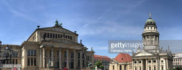 panoramic view of franzosischer dom and konzerthaus berlin against blue sky - konzerthaus berlin stock pictures, royalty-free photos & images