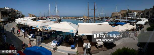 panoramic view of girne marina on a sunny spring day,northern cyprus. - emreturanphoto stock-fotos und bilder