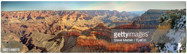 panoramic view of grand canyon against sky - steve matten stock pictures, royalty-free photos & images