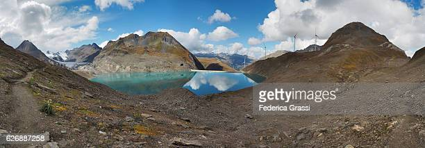 panoramic view of griessee and gries gletscher (gries lake and gries glacier) in the swiss lepontine alps - stausee stock-fotos und bilder
