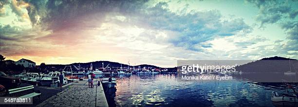 Panoramic View Of Harbor Against Cloudy Sky During Sunset