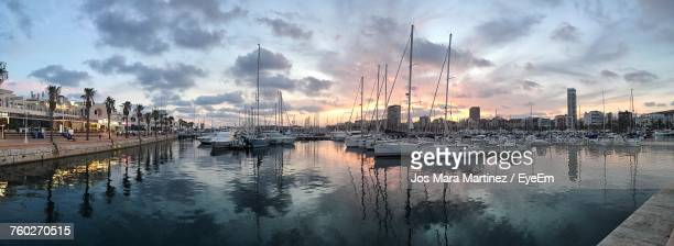 panoramic view of harbor against cloudy sky - mara martinez stock-fotos und bilder