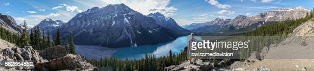panoramic view of hiker female contemplating nature from mountain top - banff stock photos and pictures