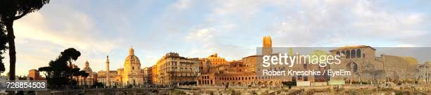 Panoramic View Of Historic Buildings Against Sky During Sunset