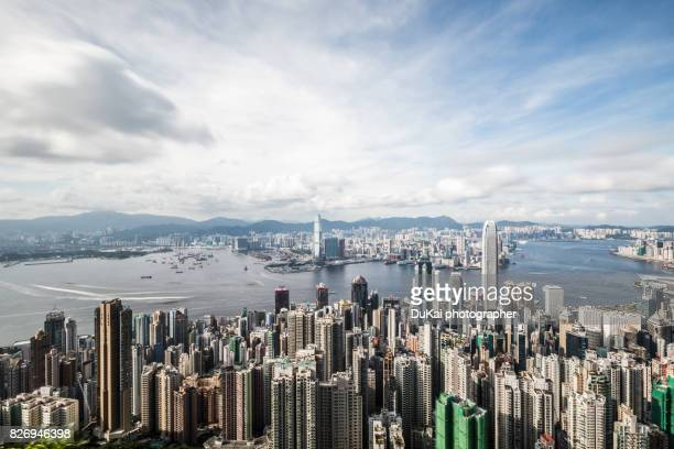 panoramic view of hong kong - hong kong victoria harbour stock pictures, royalty-free photos & images