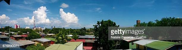 panoramic view of houses against blue sky - managua stock pictures, royalty-free photos & images