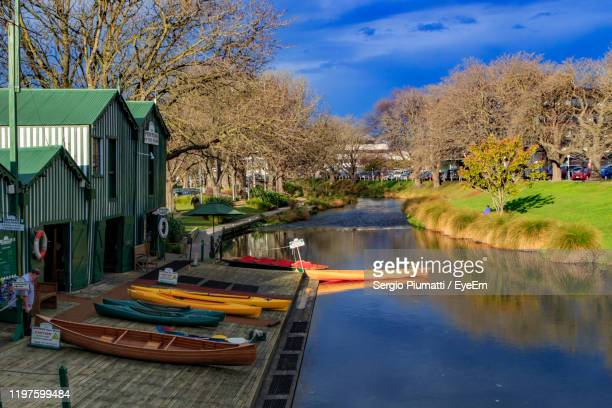 panoramic view of houses by lake against sky - christchurch stock pictures, royalty-free photos & images