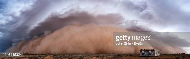 panoramic view of hut against dust storm in desert - dust stock pictures, royalty-free photos & images