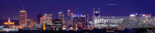 panoramic view of illuminated buildings against sky at night - nashville skyline stock pictures, royalty-free photos & images