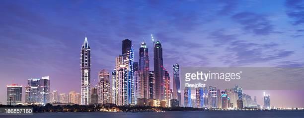 Panoramic View of Illuminated Dubai Marina Skyline at Night UAE