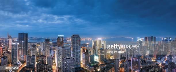 Panoramic view of illuminated modern skyscrapers at night, Dalian, Liaoning, China