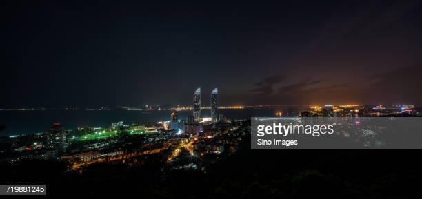 panoramic view of illuminated modern skyscrapers at night, xiamen, fujian, china - xiamen fotografías e imágenes de stock