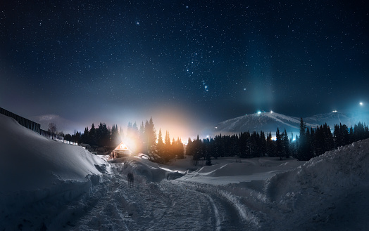 Panoramic View Of Illuminated Snowcapped Mountains Against Sky At Night - gettyimageskorea