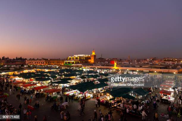 Panoramic view of Jamaa el Fna square during the sunset looking toward Cafe Argana and the covered souq on January 04 2018 in Marrakesh Morocco Jamaa...