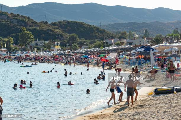 Panoramic view of Kalamitsi beach. Crowd of tourists at the popular and famous beach of Kalamitsi located on the southern tip of Sithonia peninsula...