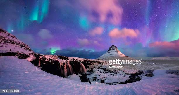 panoramic view of kirkjufell mountain with aurora - aurora borealis stock pictures, royalty-free photos & images