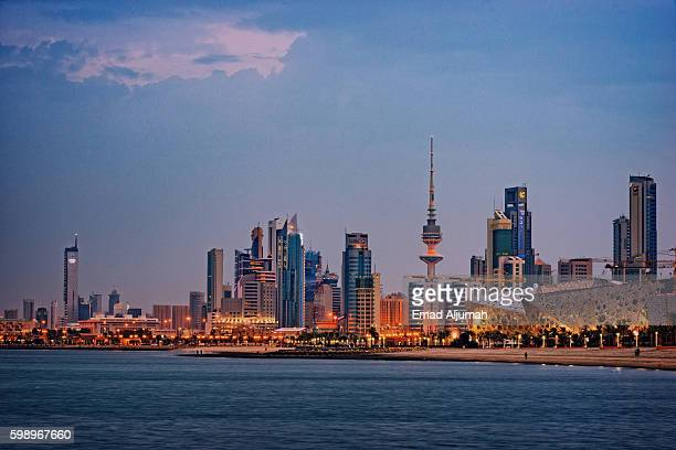 Panoramic view of Kuwait City skyline at down