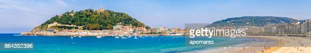 panoramic view of la concha bay and beach, san sebastian, donostia, basque country, spain - san sebastian spain stock pictures, royalty-free photos & images
