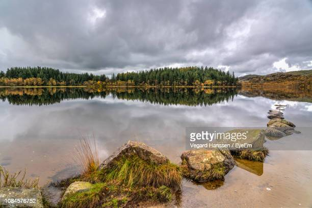 panoramic view of lake against sky - vegard hanssen stock pictures, royalty-free photos & images