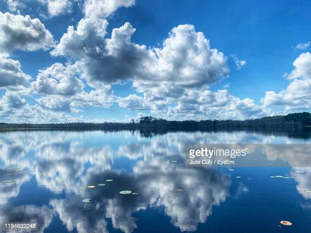 panoramic view of lake against sky - julie culy stock pictures, royalty-free photos & images