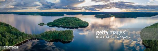 panoramic view of lake against sky - sweden stock pictures, royalty-free photos & images