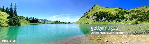 panoramic view of lake against sky - oberstdorf stock pictures, royalty-free photos & images