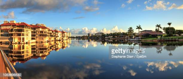 panoramic view of lake and buildings against sky - naples florida stock pictures, royalty-free photos & images