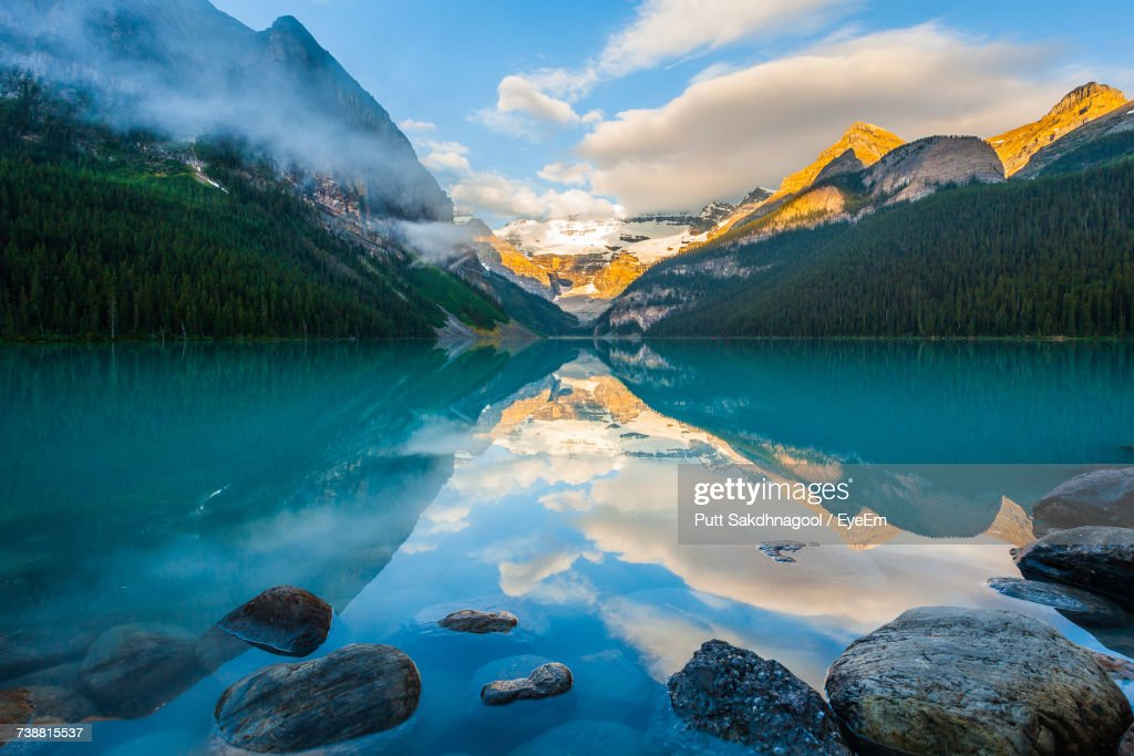 Panoramic View Of Lake And Mountains Against Sky : Stock Photo