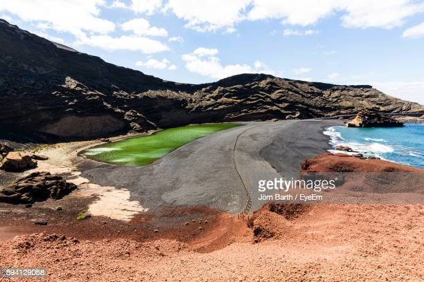 panoramic view of lake and mountains against sky - arrecife stock photos and pictures