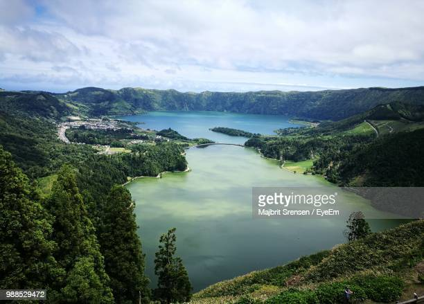 panoramic view of lake and trees against sky - ponta delgada stock photos and pictures