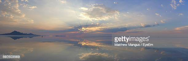 panoramic view of lake at bonneville salt flats against sky during sunset - bonneville salt flats stock pictures, royalty-free photos & images