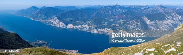 panoramic view of lake in mountains - krzysztof turek stock pictures, royalty-free photos & images
