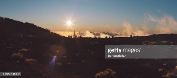 panoramic view of land against sky during sunset - bortes stock-fotos und bilder
