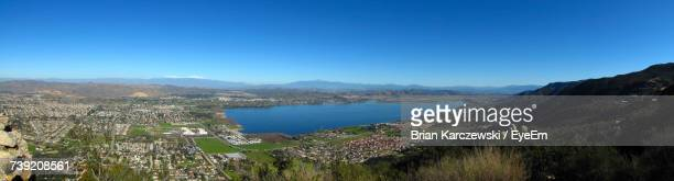 panoramic view of landscape against blue sky - lake elsinore stock photos and pictures