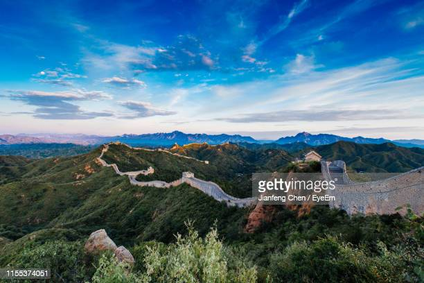 panoramic view of landscape against cloudy sky - great wall of china stock pictures, royalty-free photos & images