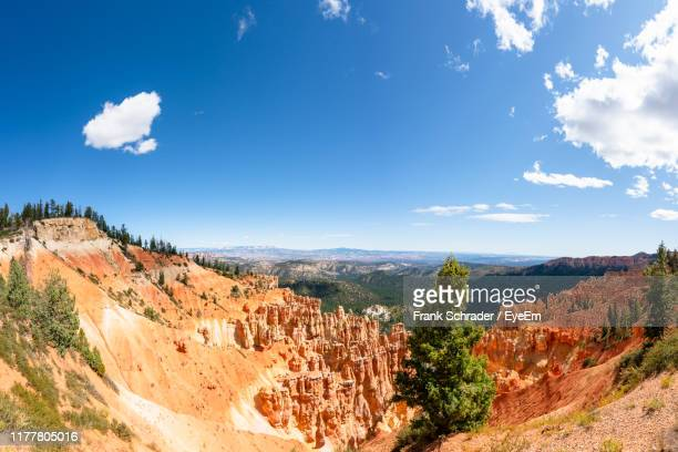 panoramic view of landscape against cloudy sky - frank schrader stock pictures, royalty-free photos & images
