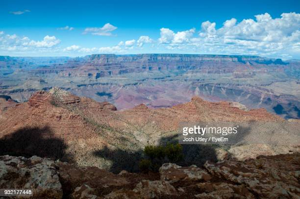 panoramic view of landscape against cloudy sky - josh utley stock pictures, royalty-free photos & images