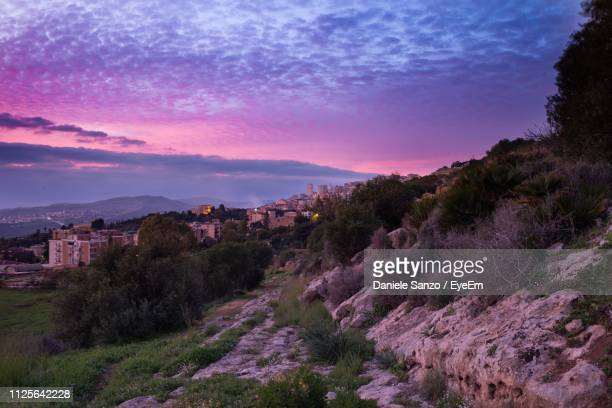 panoramic view of landscape against sky during sunset - agrigento stock pictures, royalty-free photos & images