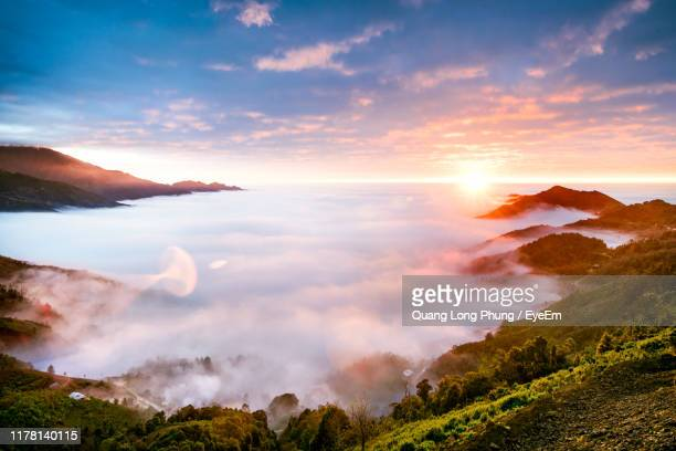 panoramic view of landscape against sky during sunset - appearance stock pictures, royalty-free photos & images